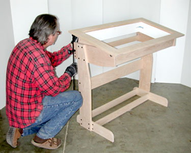 Photo of Dan working on light table